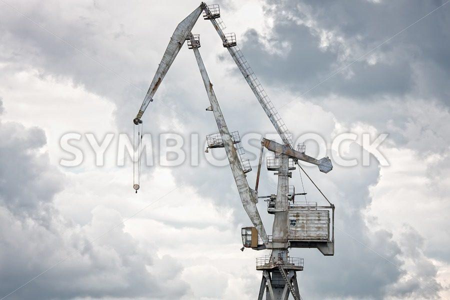 Giant old crane against dark sky - Jan Brons Stock Images