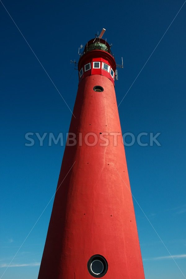 Red lighthouse - Jan Brons Stock Images