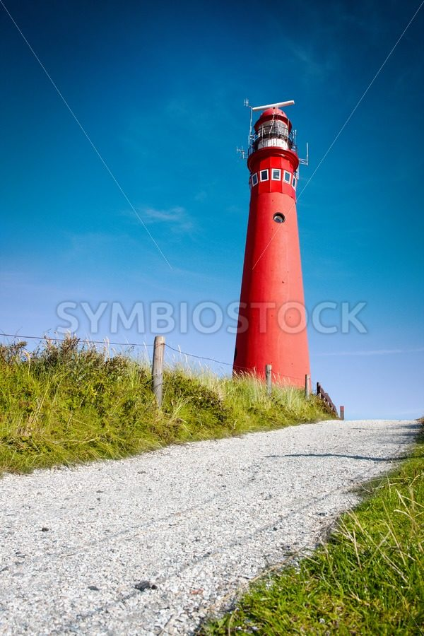 Red lighthouse and deep blue sky - Jan Brons Stock Images