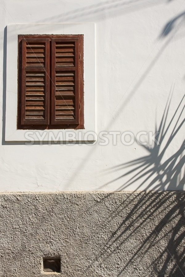 Shadows on old house