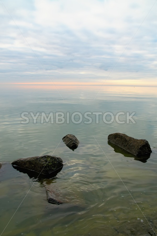 Stones in sea - Jan Brons Stock Images