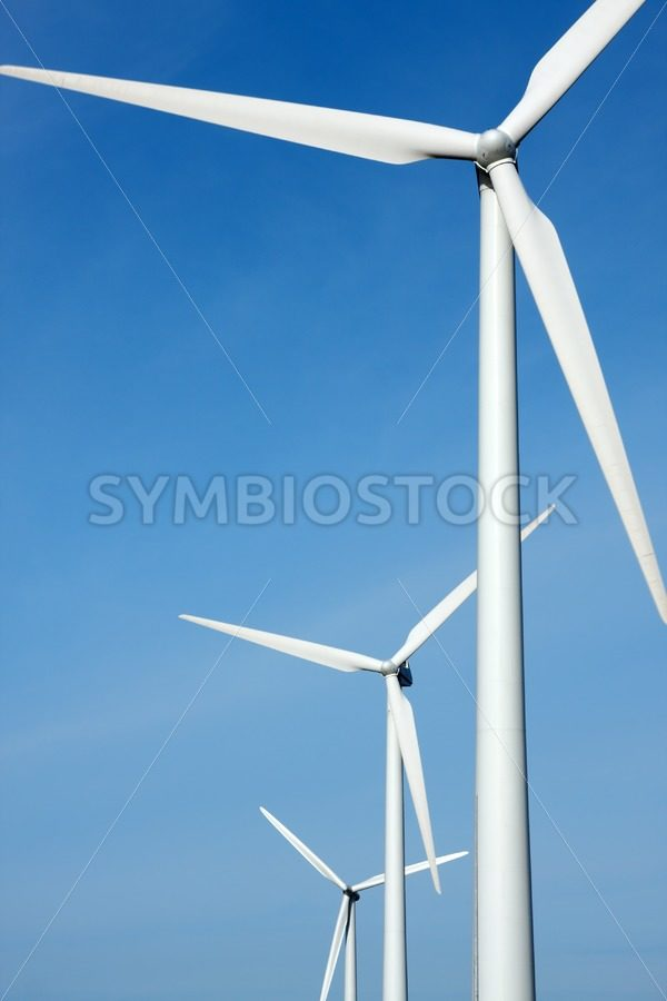 Three mighty windmills in a row - Jan Brons Stock Images
