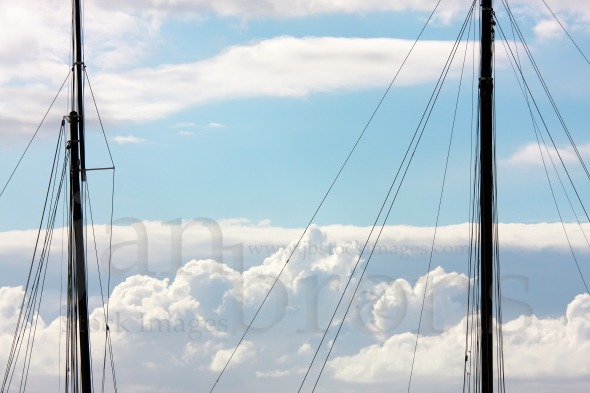 Two masts and clouds