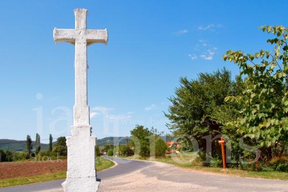 Village scene with crucifix